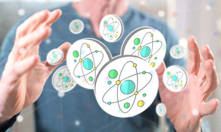 Nuclear research concept between hands of a man in background Standard-Bild