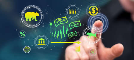Man touching a stock market concept on a touch screen with his finger Banco de Imagens