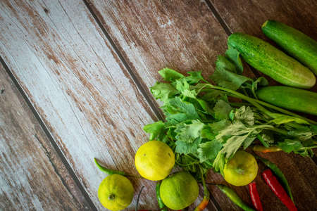 Gathering of vegetables on wood background, with Free Space for text, Top View
