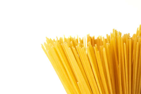 Yellow long spaghetti Yellow pasta isolated on white background,  Italian food and menu concept