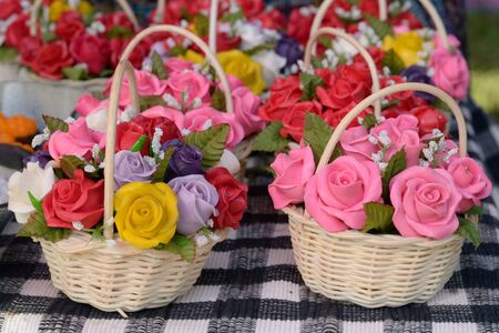 Artificial roses in basket