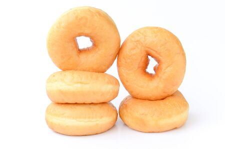 Close up plain doughnuts isolated on white background photo