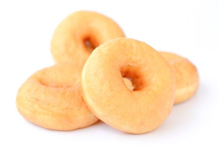 Close up plain doughnuts isolated on white background