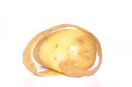 Peel the potato isolated on white background Stock Photo - 13316814