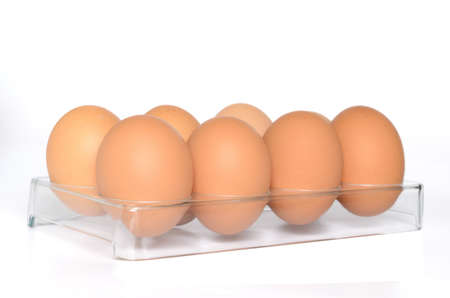 Eggs on a plastic stand on a white background Stock Photo - 13330997