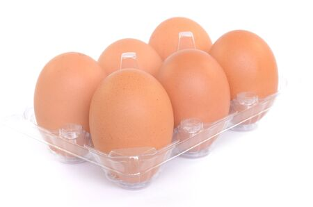 Eggs on a plastic stand on a white background