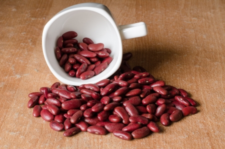 Cup of coffee on the many red beans Stock Photo