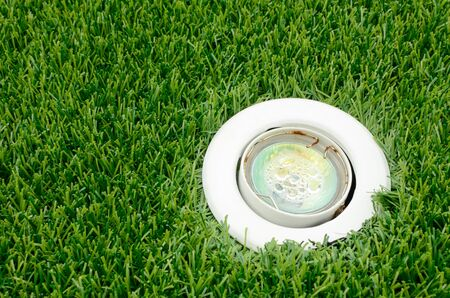 Lighting and artificial grass used in garden decorations Stock Photo