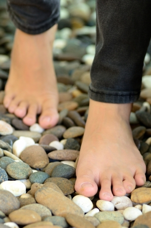 Close up of woman walking on stones for  meditation photo