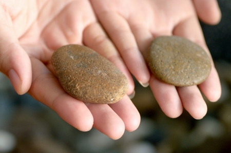 Two stones on hands for selection