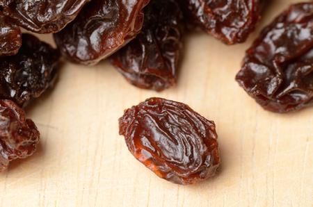 Brown raisins paste on wood photo