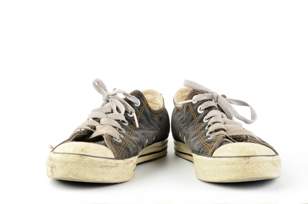 Old sneakers isolated on white