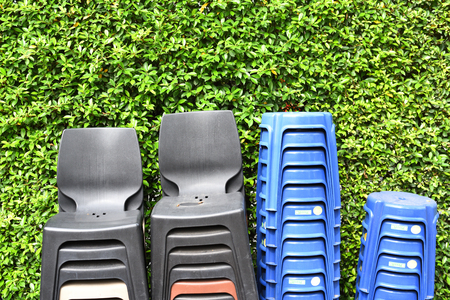 plastic chairs lined up in a park