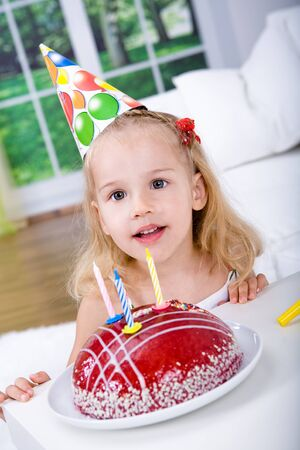 little girl child: a young girl celebrating birthday