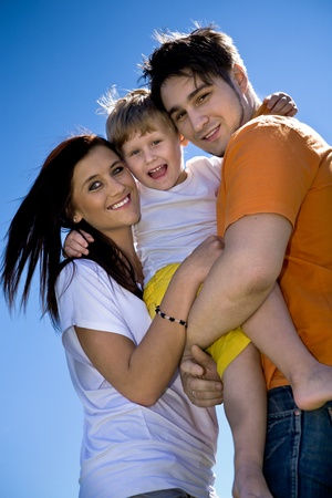 young family on the meadow at sunny day Stock Photo - 8685815
