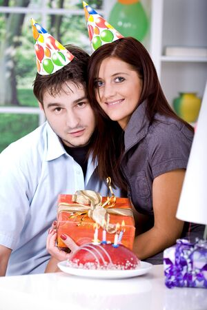 portrait of a young couple at birthday party with gifts Stock Photo - 8685822