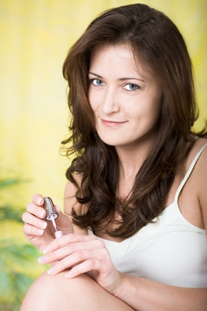 young woman making oneself up Stock Photo - 8685474