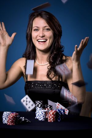 young a woman playing poker Stock Photo - 8684456