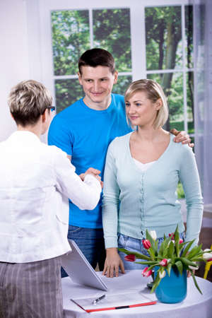 a female consultant at visiting young family Stock Photo - 8685478