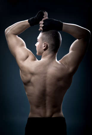 portrait of a young boxer in front of dark background Stock Photo - 8723296