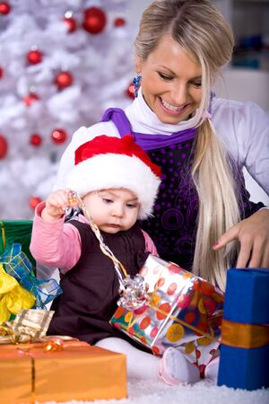 a young family getting the Christmas gift Stock Photo - 8723321