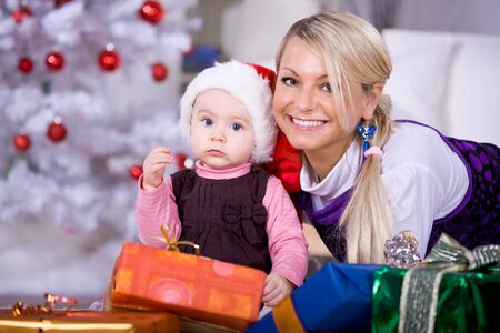 a young family getting the Christmas gift Stock Photo - 8723295