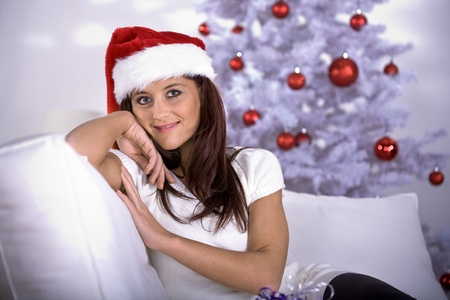 portrait of a young woman with Santa Claus hat Stock Photo - 8723323