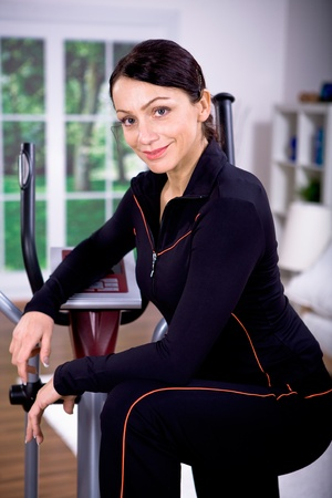 crosstrainer: young woman in sport dress on a cross-trainer Stock Photo