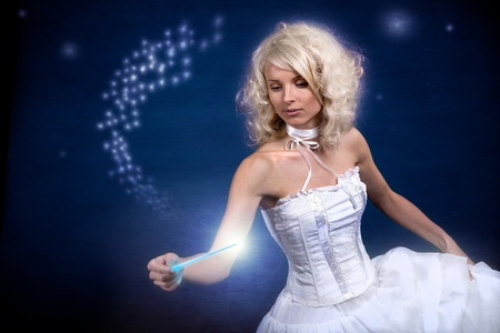 star light: A young woman as a fairy with magic wand Stock Photo