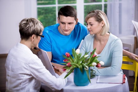 a female consultant at visiting young family Stock Photo - 8723343