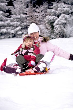 winter activities. family in the winter forest photo