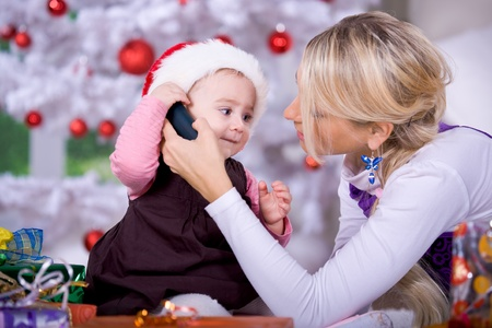 portrait of a little girl with Santa Claus hat by calling photo