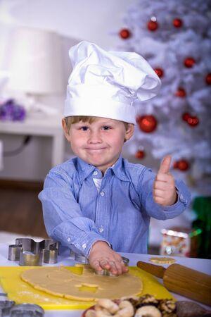 boy making xmas cookies at home Stock Photo - 8723408