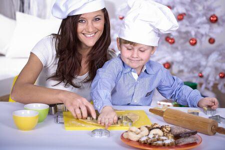 family making xmas cookies at home photo