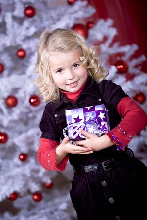a little girl geting the Christmas gift Stock Photo