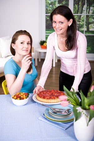 two young women with fresh strawberry cake Stock Photo - 9353767