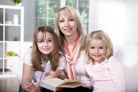 young family at reading in the flat photo