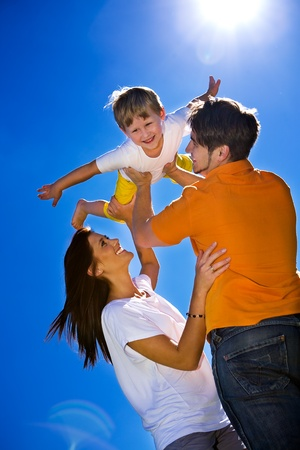 family activities: young family on the meadow at sunny day Stock Photo