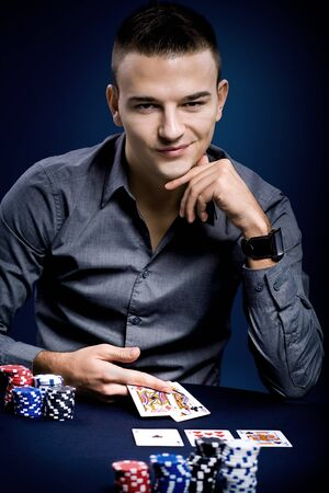 poker cards: a young man playing poker