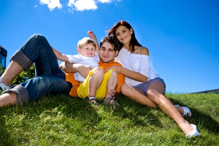young family on the meadow at sunny day Stock Photo