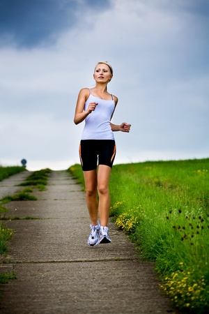 A woman jogging in front of cross country Stock Photo - 9425777