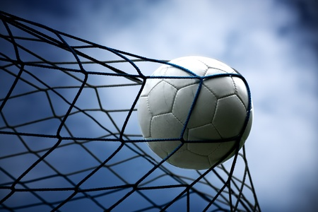soccer kick: a soccer ball in the goal Stock Photo