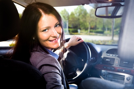 woman driving: a young woman driving the car