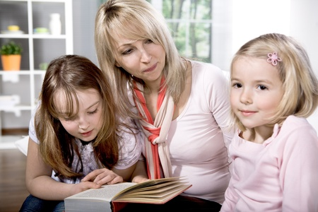 young family at reading in the flat