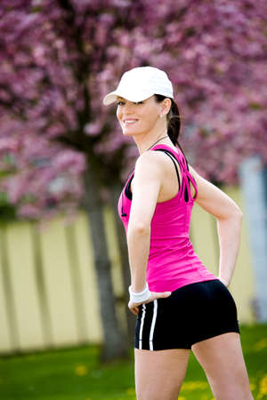 A young woman stretching for jogging Stock Photo - 9879250