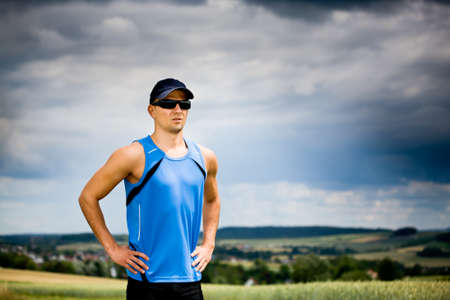 man jogging through the fields Stock Photo - 9879138