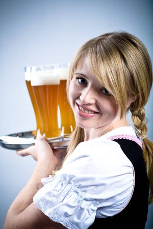 portrait of young bavarian girl in the dirndl photo