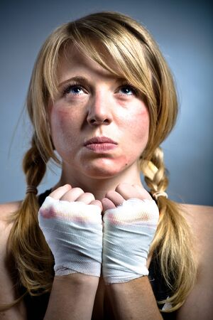 female boxer in a fighting pose photo