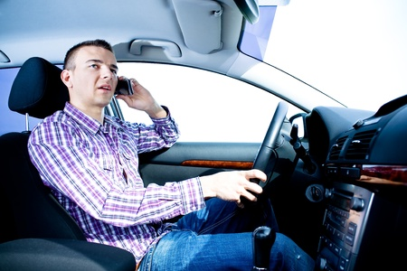 a young man driving the car Stock Photo - 10039875