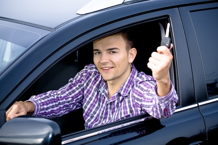a young man driving the car Stock Photo - 10039880